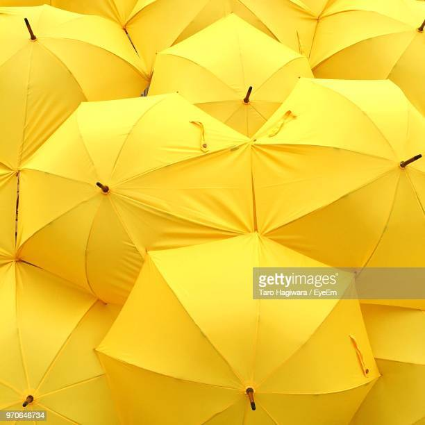 full frame shot of yellow umbrellas - umbrella stock pictures, royalty-free photos & images