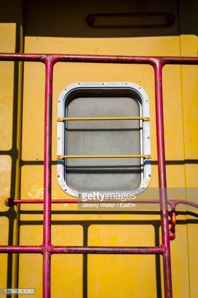 full frame shot of yellow wall and red railing on train - eyeem jeremy walter stock pictures, royalty-free photos & images
