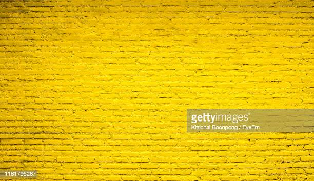 full frame shot of yellow wall - brick wall stock pictures, royalty-free photos & images
