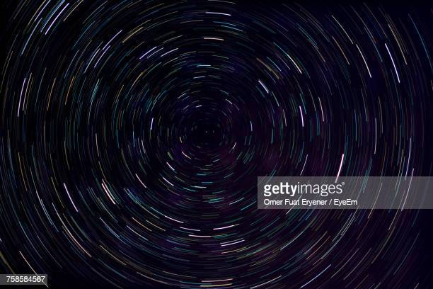 full frame shot star trail at night - costellazione foto e immagini stock