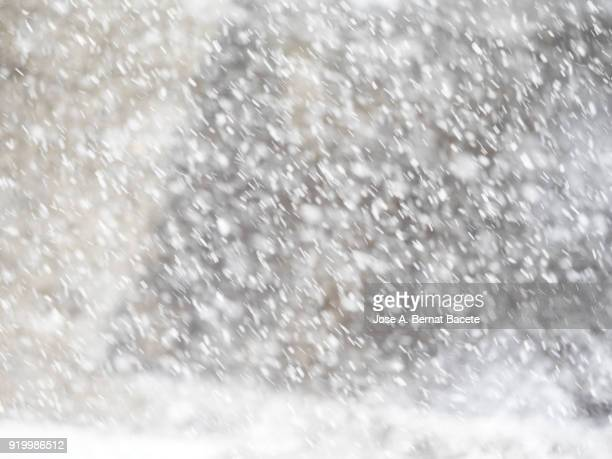 full frame snowstorm with the bottom of a stone wall. spain. - 吹雪 ストックフォトと画像