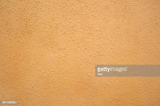 full frame texture, saturated yellow cement wall - stucco stock pictures, royalty-free photos & images