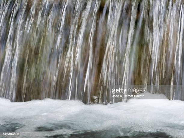 Full frame water source that falls down in the shape of waterfall