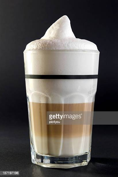 Full glass of coffee with foam on top