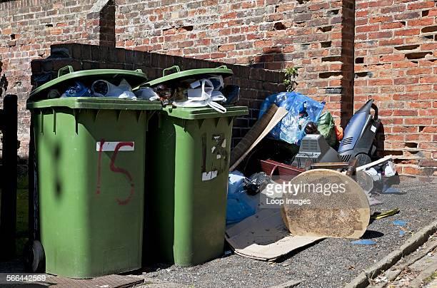 Full household waste wheelie bins and rubbish.