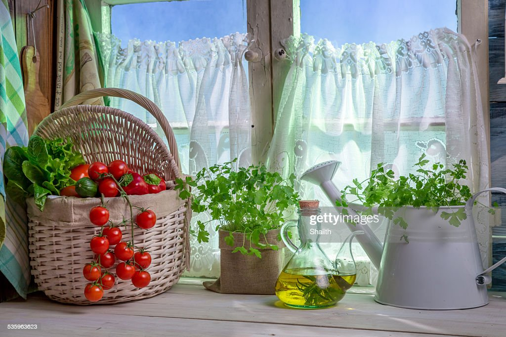 Full kitchen with fresh spring vegetables : Stock Photo