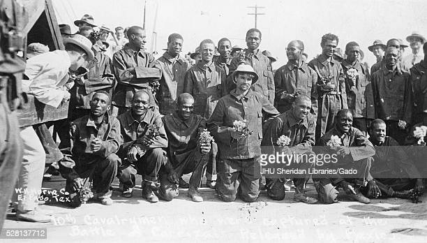 Full landscape shot of American soldiers in the 10th cavalry during World War 1 most African American wearing uniforms two rows of men first row...