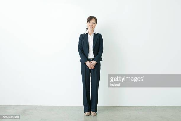 full lenghth of businesswoman - asian 50 to 55 years old woman stock photos and pictures
