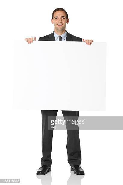 full length businessman holding blank sign - blank sign stock photos and pictures