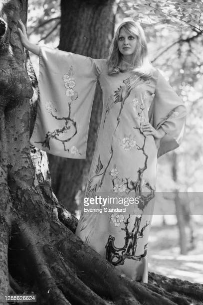 Full length dress with kimono sleeves and a Japanese-style painting of cranes and flowers, UK, 1971.