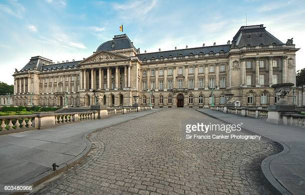 Full length facade of Royal Palace with national flag, Brussels, Belgium