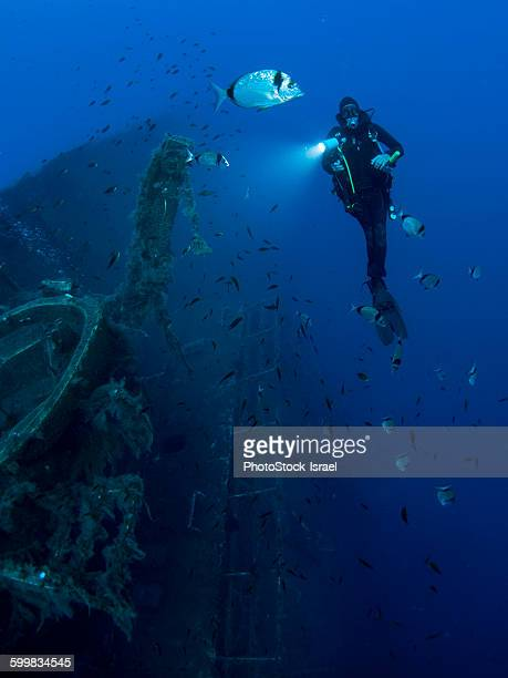 Full length front underwater view of diver investigating MS Zenobia shipwreck, Larnaca, Cyprus