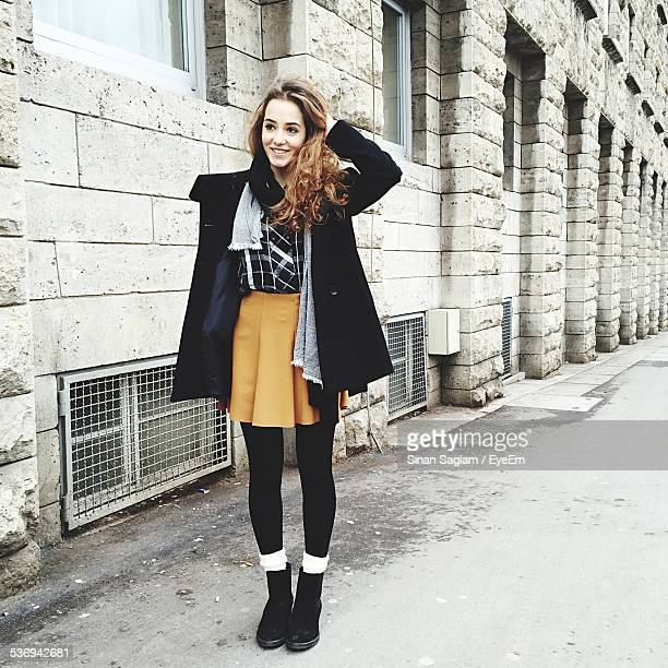 full length happy teenage girl on street - skinny teen stock photos and pictures