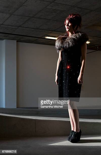 Full length image of fashion model looking away