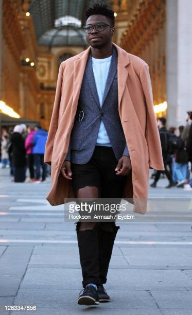 full length of a man walking in the city - catwalk stock pictures, royalty-free photos & images