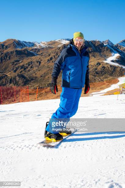 Full Length Of A Person Snowboarding