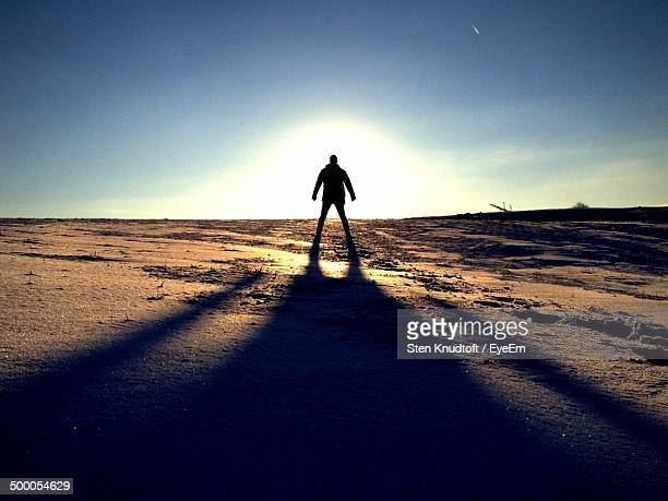 Full length of a silhouette man standing on landscape