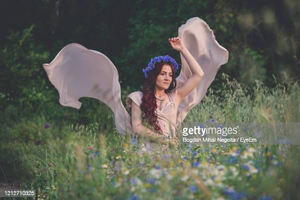 full length of a smiling young woman on field - bogdan negoita stock pictures, royalty-free photos & images