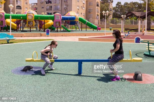 Full Length Of A Woman And A Girl On Playground