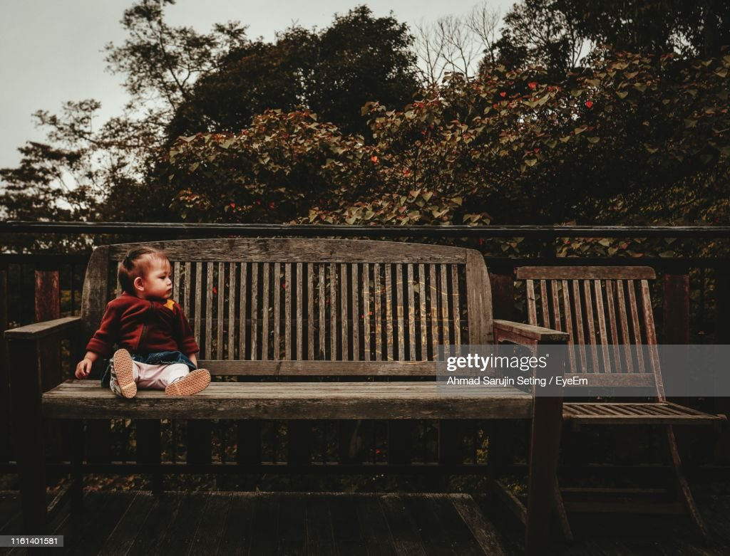 Superb Full Length Of Baby Boy Sitting On Wooden Bench Stock Photo Ocoug Best Dining Table And Chair Ideas Images Ocougorg