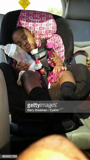 Full Length Of Baby Sleeping On Seat In Car
