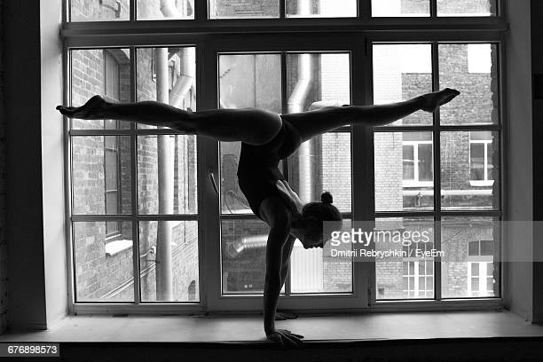Full Length Of Ballet Dancer In Handstand