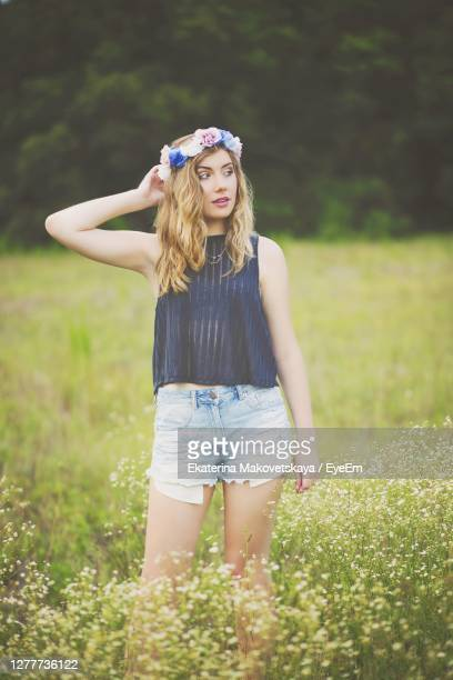 full length of beautiful young woman standing on field - tiara stock pictures, royalty-free photos & images