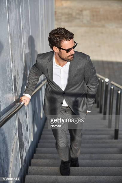 Full length of businessman walking on steps