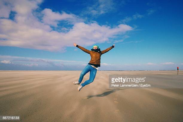 Full Length Of Carefree Woman On Beach Landscape