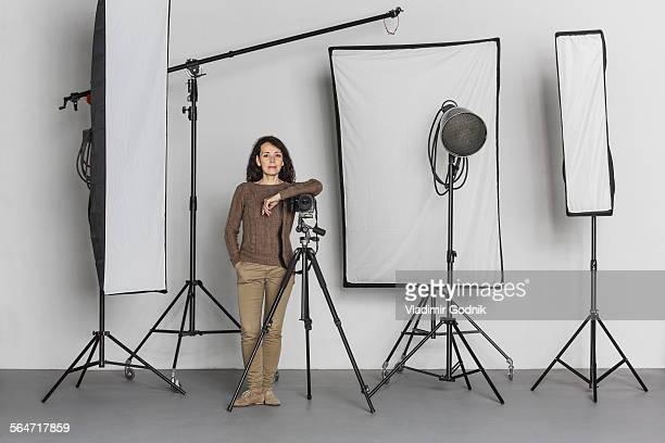 Full length of confident mature female photographer in photo studio