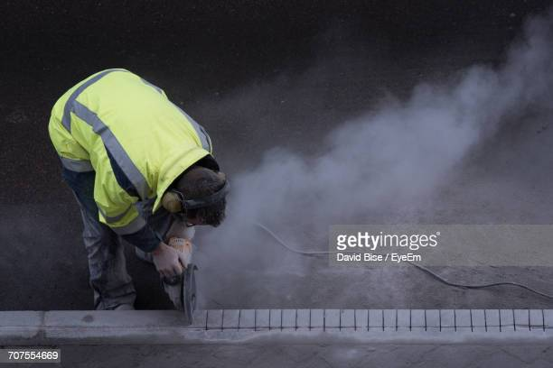 Full Length Of Construction Worker Working On Street