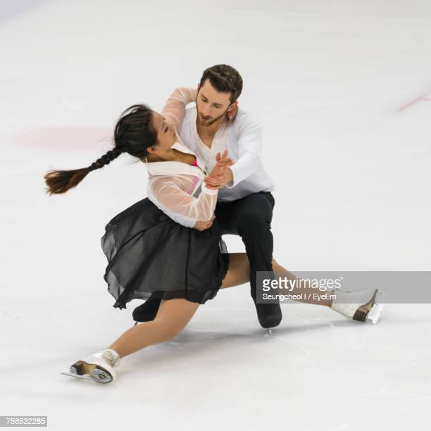 Full Length Of Couple Figure Skating
