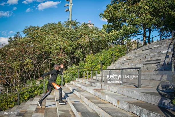Full length of fit young man jogging on steps