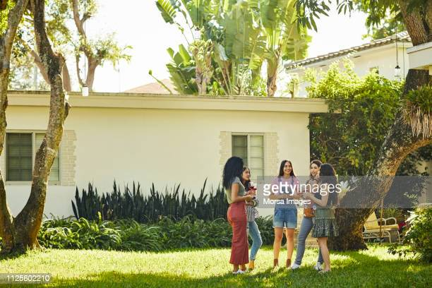 full length of friends standing together at party - of miami photos stock pictures, royalty-free photos & images