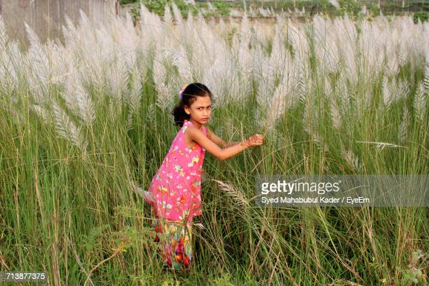 full length of girl on grassy field - bangladeshi beautiful girl stock photos and pictures