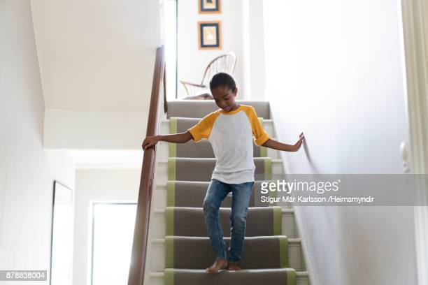 Full length of girl on staircase at home