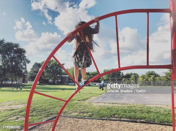 Full Length Of Girl Playing At Playground
