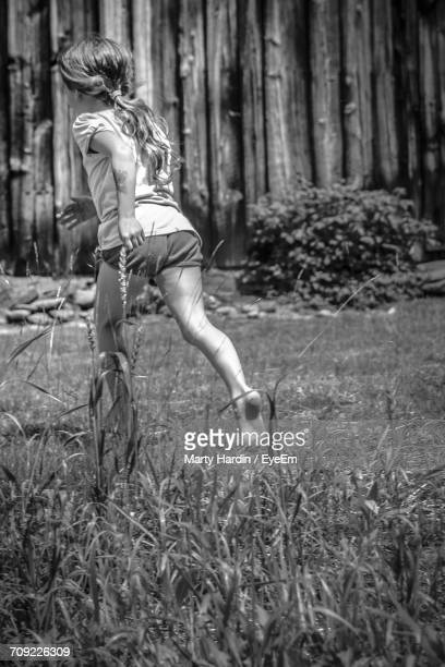 full length of girl running - marty hardin stock photos and pictures