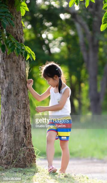 Full Length Of Girl Standing By Tree