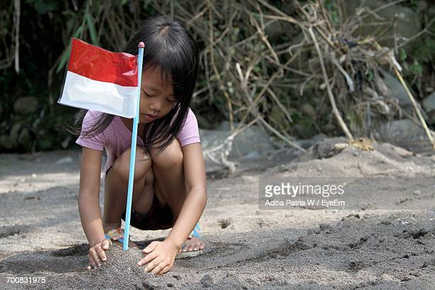 full length of girl with flag - indonesia flag stock photos and pictures