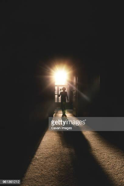 full length of girl with magic wand walking from doorway during sunny day - magic doors stock pictures, royalty-free photos & images