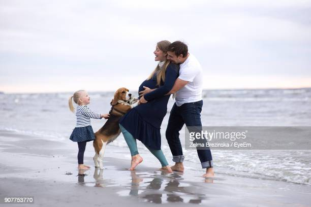 Full Length Of Happy Family At Beach