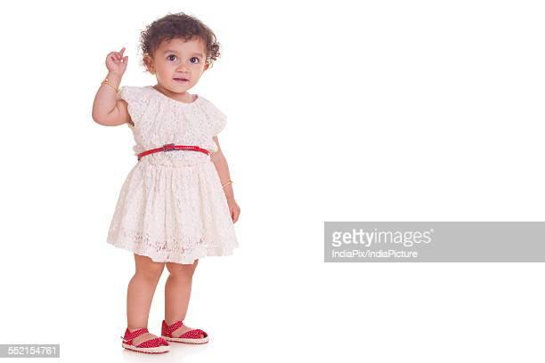 Full length of innocent girl against white background