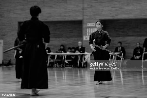 full length of man and woman practicing kendo - girl fight stock photos and pictures