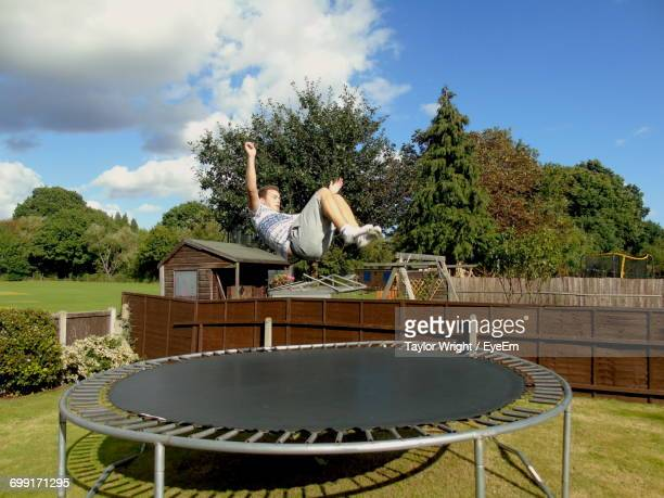 Full Length Of Man In Mid-Air Over Trampoline At Park