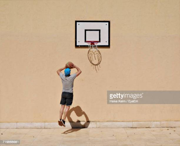 Full Length Of Man Playing Basketball