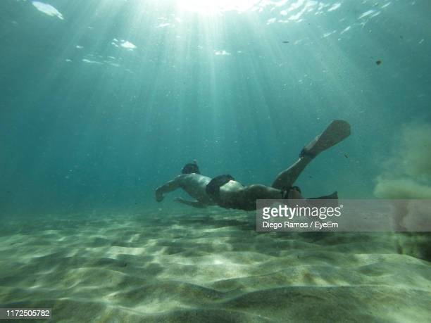 full length of man snorkeling in sea - alicante stock pictures, royalty-free photos & images