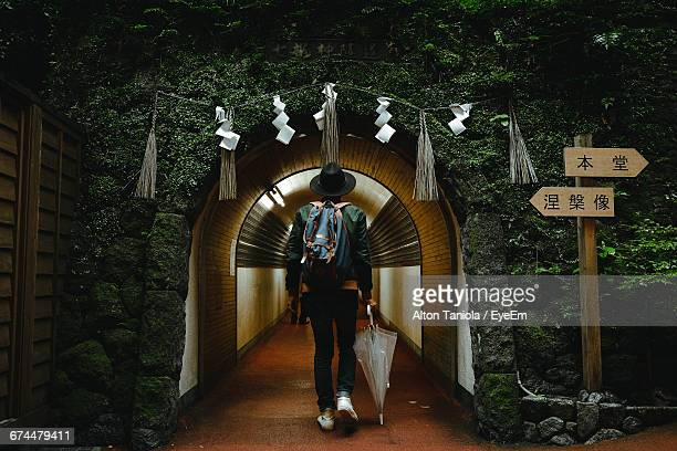 Full Length Of Man Standing In Front Of Tunnel