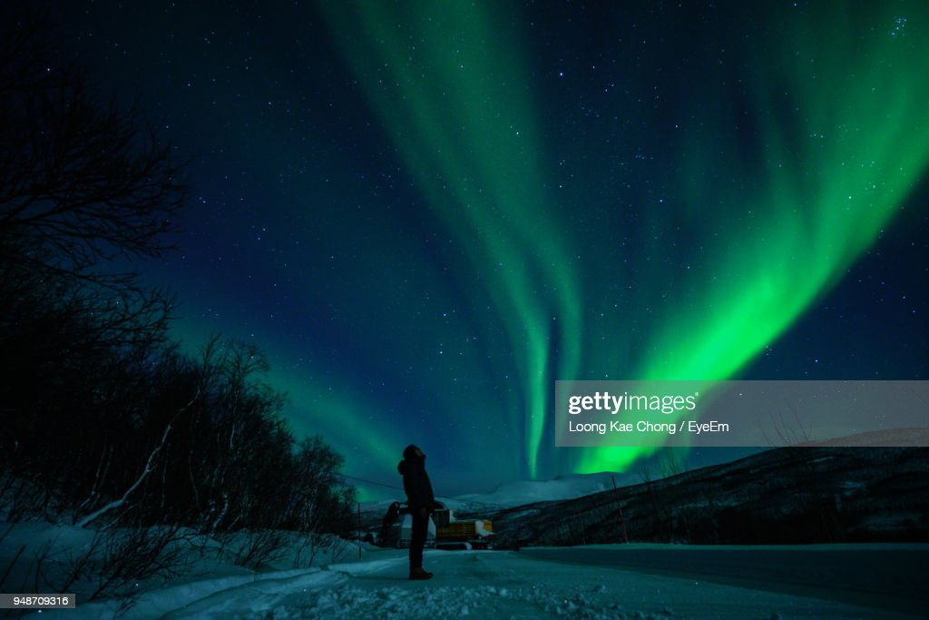 Full Length Of Man Standing On Field Against Sky At Night : Stock-Foto