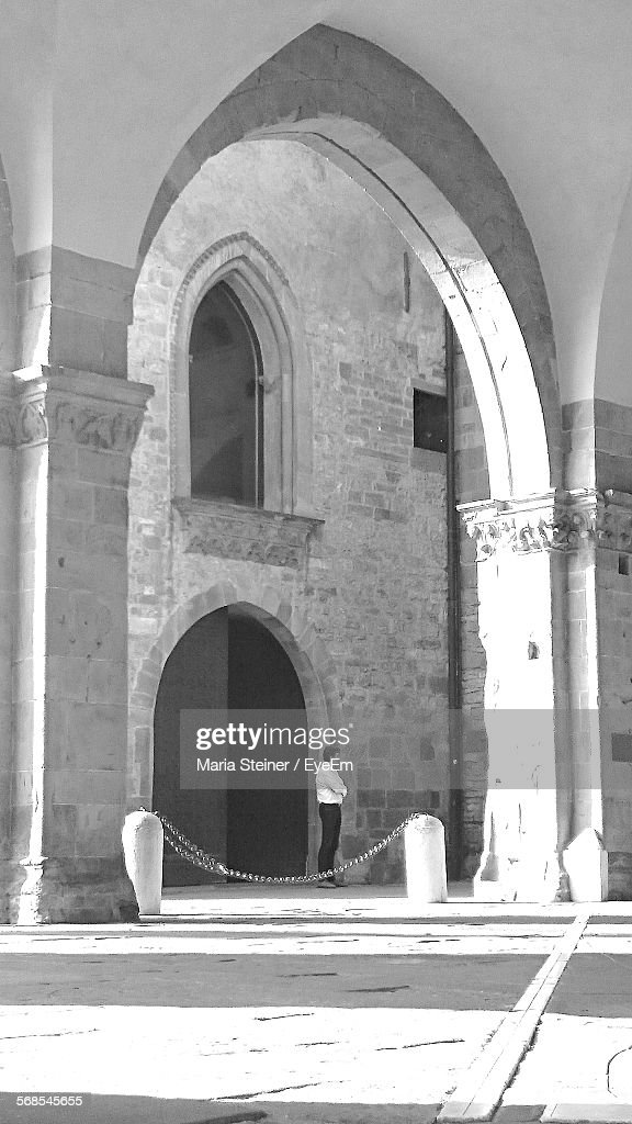 Full Length Of Man Standing Seen Through Arch : Stock Photo